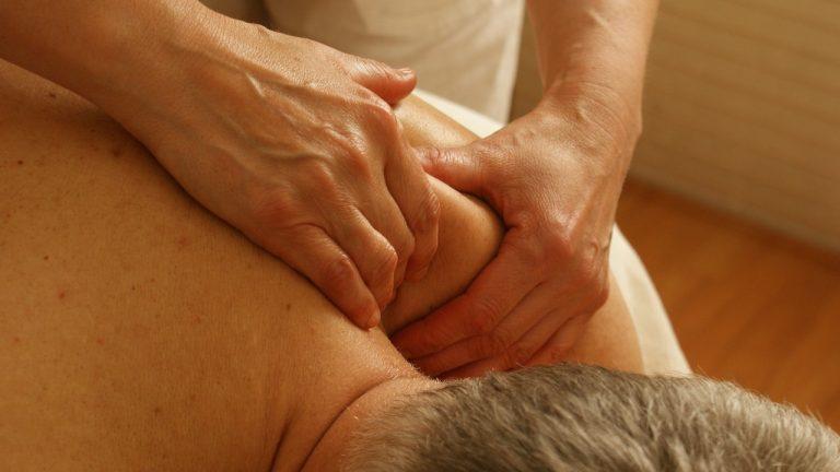 Swedish massage on shoulder